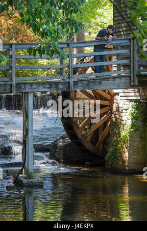 An old stone grist mill wheel outside the brandywine river for Stone mountain fishing