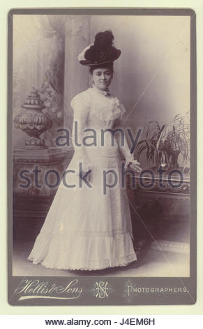 Cabinet card of fashionable, elegant, attractive beautiful Victorian young lady wearing a hat, circa early 1890's, - Stock Photo