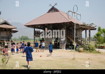 Thai student visit and educational tour at Tai Dam ethnic museum house and playing tradition game of Tai Dum people - Stock Photo