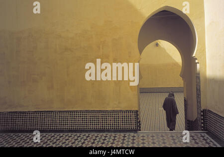 Morocco, Meknes, mausoleum Moulay Ismail, walls, yellow, archways, man, back view Africa, town, Moulai Ismail Mausoleum, - Stock Photo