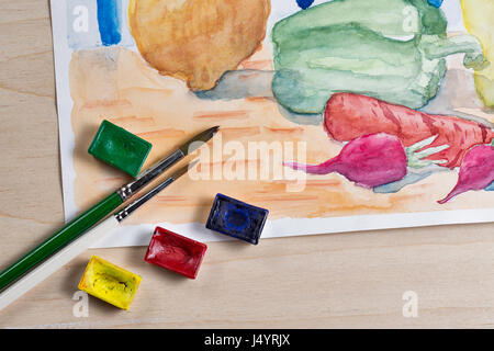 Still life with watercolor paint. Vegetables on the kitchen table. Onions, carrots, peppers and radishes. Brush - Stock Photo