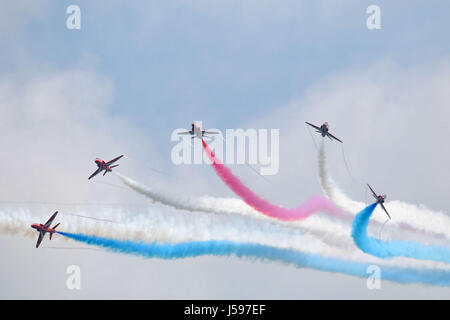 Red arrows aerobatic display team burst over Eastbourne UK - Stock Photo