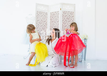 Woman and children in bedroom - Stock Photo