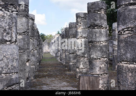 Columns in the Temple of a Thousand Warriors in Chichen Itza ruins, Maya civilization, Mexico - Stock Photo