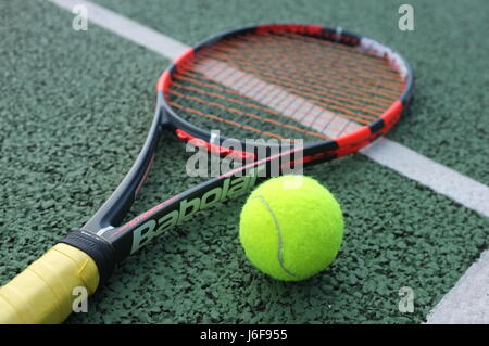 ... Tennis ball on a Babolat racquet on a hard court in London, UK - Stock