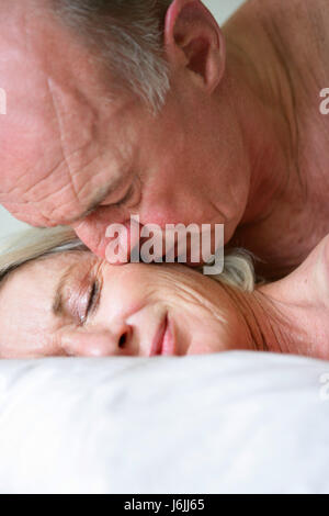 profile lie lying lies sleep sleeping tenderness front view seniors senior - Stock Photo