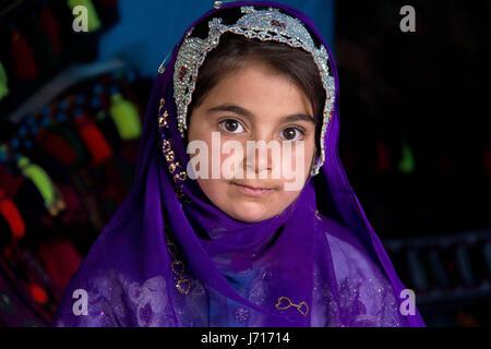 Bakhtiari girl wearing traditional costume in Chelgerd, Iran - Stock Photo