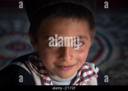 Bakhtiari kid wearing traditional costume in Chelgerd, Iran - Stock Photo