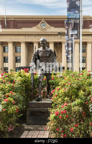 Wellington, New Zealand - March 10, 2017: Classic iconic Mahatma Gandhi bronze statue in front of yellow central - Stock Photo