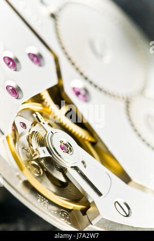 clockwork with gear wheels - Stock Photo