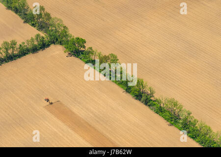 Aerial View Of Tractor Plowing Farm Field - Stock Photo