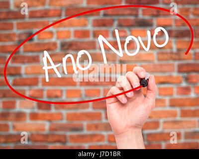 Man Hand writing OMG (Oh My God) with black marker on visual screen. Isolated on bricks. Business, technology, internet - Stock Photo