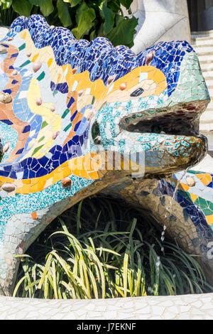 A mosaic tiled salamander, El Drac, in Antoni Gaudi's Park Güell, Barcelona, Spain - Stock Photo
