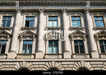 Windows on historic building facade with columns - Stock Photo
