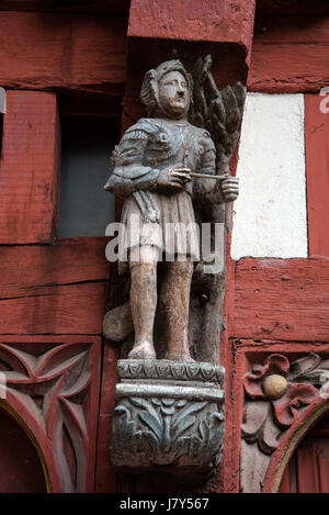 Medieval carved figure on facade of half-timbered house Ti Koz, built in 1505, in Rue de Guillaume, Rennes, Brittany - Stock Photo