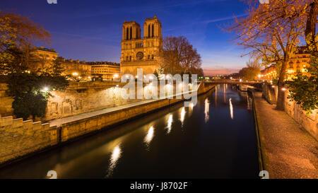 Notre Dame de Paris cathedral on Ile de La Cite at dawn with the Seine River. Daybreak in the 4th Arrondissement, - Stock Photo