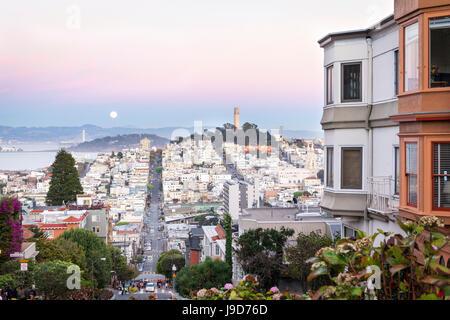 Super moon and view to Bay Area, including San Francisco-Oakland Bay Bridge, San Francisco, California, USA - Stock Photo