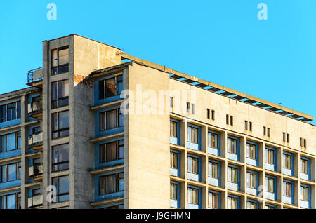 Top part of facade moden building. Detail of hostel building against blue sky background. Ussr architecture - Stock Photo