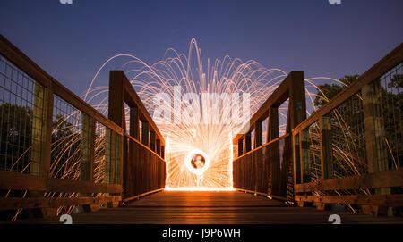Steel Wool Photography Sparks on Bridge - Stock Photo
