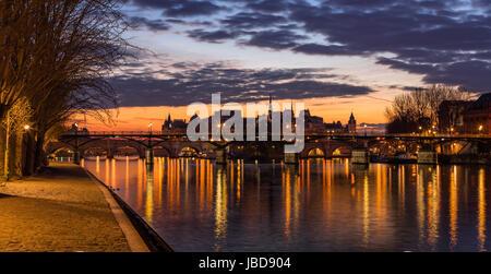Sunrise on Ile de la Cite and the Seine River with view of Pont des Arts. 4th Arrondissement. Paris, France - Stock Photo