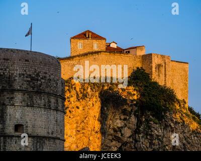 Old town Dubrovnik in Croatia Bokar fort lit by sunset warm light - Stock Photo
