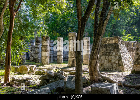 The columns in the Thousand Warriors Temple complex at Chichen Itza Mayan Ruins - Yucatan, Mexico - Stock Photo