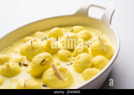 Angoori rasmalai or anguri ras malai is an Indian dessert. Made from cottage cheese which is then soaked in chashni, - Stock Photo