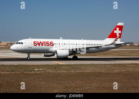 Commercial air transport. Swiss International Air Lines Airbus A320 taxiing for departure from Malta - Stock Photo