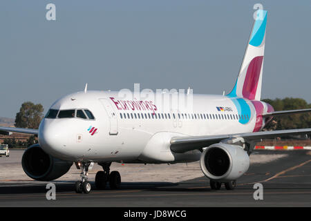 Commercial aviation. Eurowings Airbus A320 taxiing for departure from Malta - Stock Photo