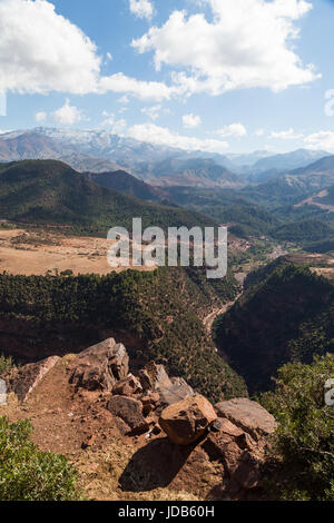 A deep gorge cuts through the arid scenery of the Atlas mountains in Morocco - Stock Photo