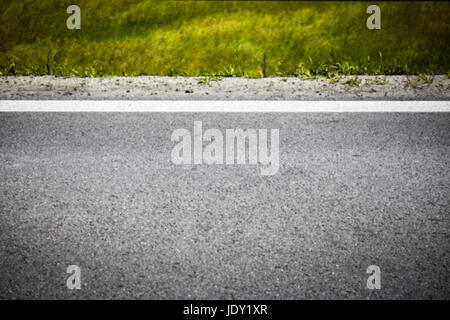 Blurred picture of an asphalt road, conceptual background with vignetting effect. - Stock Photo