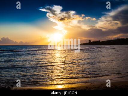 Sunset over Treasure cove in Jamaica - Stock Photo