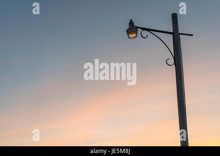 A lamp post at sunset - Stock Photo