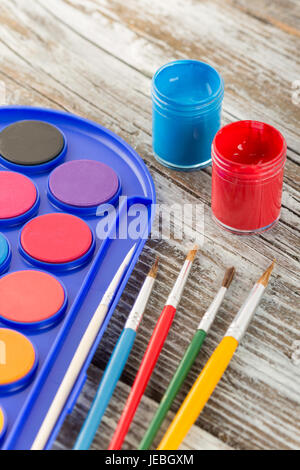 paint brushes on wooden background, special tools for creative people, back to school, education background, - Stock Photo