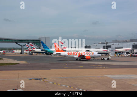 Civil aviation. London Gatwick Airport, UK, with an easyJet Airbus A319 in the foreground - Stock Photo