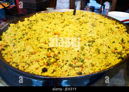 Spanish paella in a large wok - Stock Photo