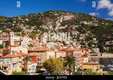 View of colourful apartment and Welcome hotel building facades and harbour with pleasure boats anchored in bay; - Stock Photo