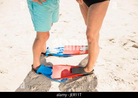 Senior couple wearing flippers - Stock Photo
