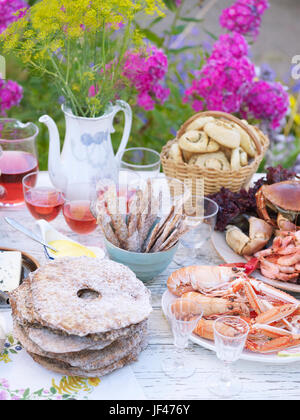 Food on table in garden - Stock Photo