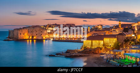 Croatia Dubrovnik Croatia Dalmatian coast view of Dubrovnik old Town illuminated city walls old port and harbour - Stock Photo