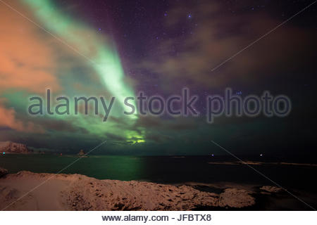 An aurora borealis above the sea in Andenes. - Stock Photo