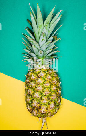 Ananas over a brazilian flags background - Stock Photo