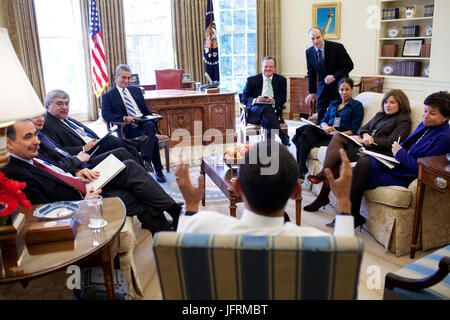 President Barack Obama meets with senior advisors in the Oval Office. 2/2/09. Official White House Photo by Pete - Stock Photo
