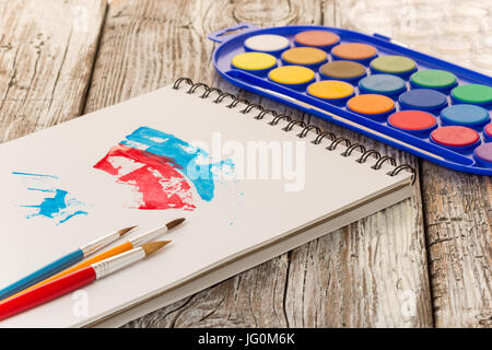 watercolor painting, special painting tools on wooden background - Stock Photo