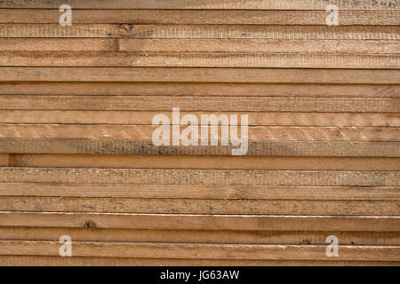 stacked wood boards - stack wooden planks  wooden background - Stock Photo
