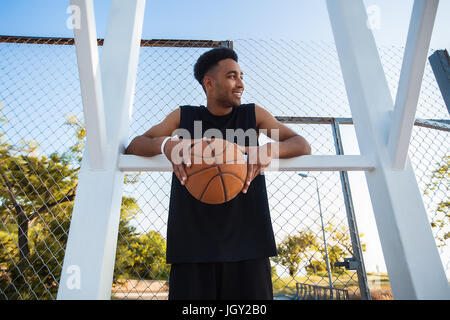 Young man in basketball court - Stock Photo