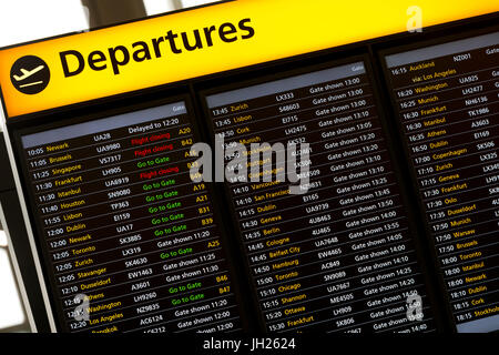 Departures Sign in London Heathrow Airport, London, England, United Kingdom, Europe - Stock Photo