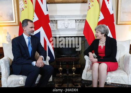 London, UK. 13th July, 2017. British Prime Minister Theresa May and Spain's King Felipe stand together as they pose - Stock Photo