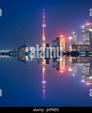 Aerial panoramic view over a big modern city by night. Shanghai, China. Nighttime skyline with illuminated skyscrapers - Stock Photo