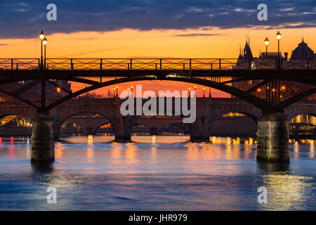 Sunrise on the Pont des Art, Pont Neuf and the Seine River Banks. 1st Arrondissement, Paris, France - Stock Photo